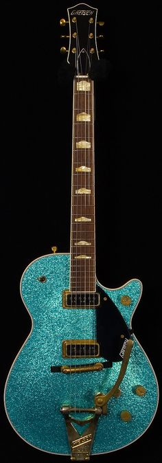 Gretsch custom shop, check this masterbuilt 1957 duo jet relic with Bigsby in Turquoise sparkle