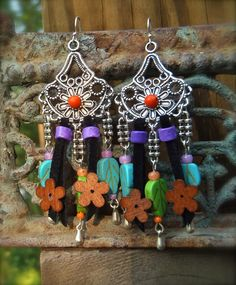 HIPPIE CHIC earrings SUMMER colors western jewelry colorful sterling silver festival Leather earrings Flower power. $35.00, via Etsy.