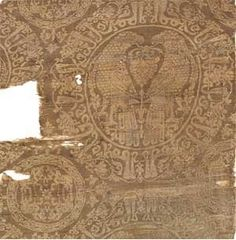 Seljuk silk Lampas robe fragment with roundels and mirrored inscriptions from 10-11th c: