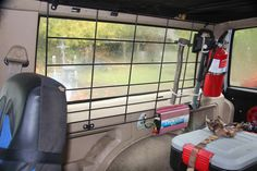 Wire Window Rack Jeep XJ, axe and gas filler tied on. Need to build gun holders next.