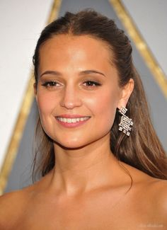 Alicia Vikander in a custom Louis Vuitton dress and Louis Vuitton High Jewelry earrings at the 2016 Oscars, where she won the Best Supporting Actress award for 'The Danish Girl'