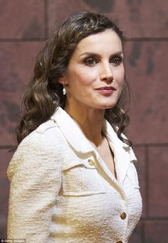 Queen Letizia opted for a popular boho hairstyle on Tuesday sporting a braid during her en...