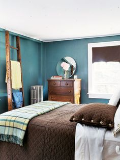 Blue and Green and Brown Allover                  Deep blue-green walls can be a powerful statement in a bedroom. For such a dominating shade, choose similar, lighter hues like sea foam or pale blue in order to pick up the light. Natural tones like the chocolate brown coverlet and pillow sham compliment, rather than compete with the background.