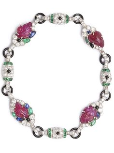An Art Deco emerald, ruby, sapphire, onyx, diamond, enamel, and platinum tutti frutti bracelet, United States, circa 1930.