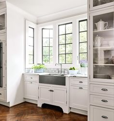 An alcove in the new kitchen encloses the cleanup zone. Flat-panel cabinets, some with furniture feet, nod to the when the house was built. Kitchen Interior, New Kitchen, Kitchen Decor, Kitchen Tiles Design, Tile Design, Home Renovation, Home Remodeling, Home Kitchens, House Design