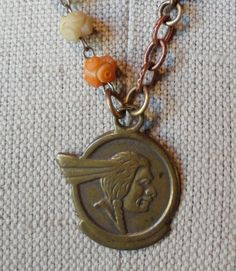 Free gift bracelet Vintage Indian fob 1955 Pontiac brass glass Germany japan Unisex found object Necklace Unisex Lux Revival collage. $165.00, via Etsy.
