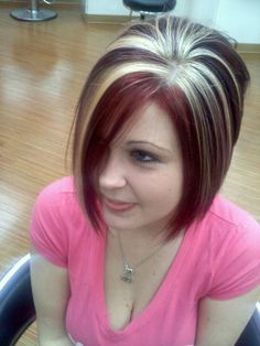 Chunky highlights platinum vibrant red violet angled bob