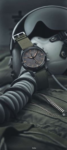 IWC Big Pilot's Watch Top Gun Miramar | The Top Gun Miramar (also available in a chronograph version) has a big, 48-mm ceramic case and anthracite dial. The hands and chapter rings are in a camouflage beige color and the military-green textile strap is reminiscent of the fabric webbing belts in an aircraft cockpit. | WatchTime