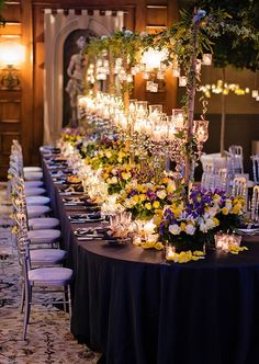 Flowers and more than 2,000 candles decorate the Four Seasons Hotel Florence reception space and its immaculate tables.