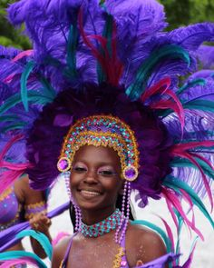 The beautiful colors of her costume simply enhance her own beauty. St Thomas.