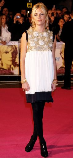 Sienna Miller in an embellished mini dress and tights