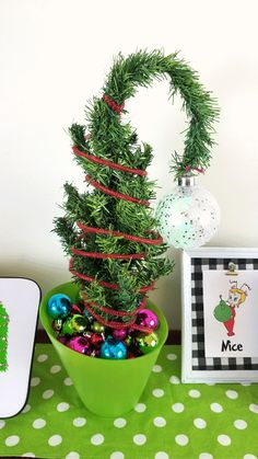 Create a tabletop Grinch curved tree with Dollar Tree products. It is small but it is fun and festive and says Grinch all over it! #grinch #grinchcrafts #dollartreecrafts