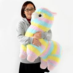 """… *Hellooo?* … *Is anyone there?* … Oh my, we're so sorry! We just passed out from the cuteness! Seriously though, have you ever seen anything so cute?! This **super jumbo size Rainbow Alpacasso plushie** is surely the epitome of fluffy Alpacasso adorableness. Standing at an impressive **23.6""""** at its tallest point, this lofty Alpacasso plushie is actually big enough to ride on! Just jump on and away you go on a magical rainbow adventure!"""