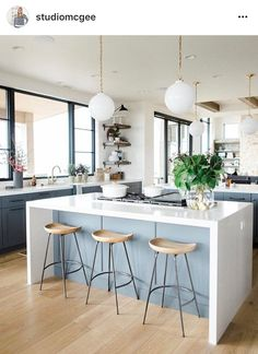 Love the T style kitchen with 2 islands