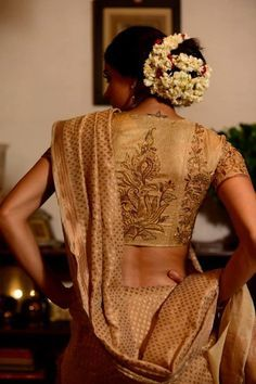 Gold bridal silk saree by Lakshmi - A look we've seen several brides pull off with élan, the all gold silk saree. #indian #christian