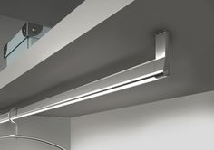 "Giuseppe Bavuso's Goccia LED closet rod for a cool white light & average life rating of 50,000 hours - ""prestige price point"" & best for closets with space between the garments."