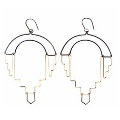 incredible earrings from by boe - striking that balance between architectural and delicate.