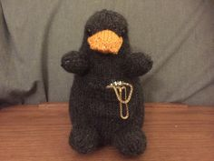 """Finished him! Now, by request, here's the pattern. Let me know if you have any questions. Note: I am not responsible for missing valuables that may or may not end up in your niffler's pouch. """"Materials: LB Collection Baby Alpaca in Silver Gray..."""