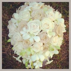 Gorgeous bridal bouquet with roses & orchids  By Flowers by REN