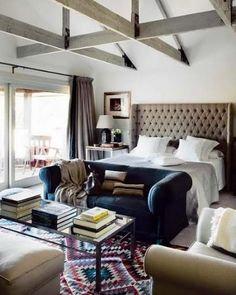 I think I'd hardly leave this room if it were mine. Love: beamed ceiling, reading spot at the foot of the bed, lots of natural light.