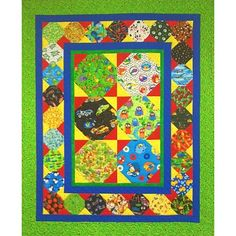 I Spy All Around. This pattern is quick and easy, but still has some nice flair to it. I love collecting all those special fabrics for an I Spy quilt.