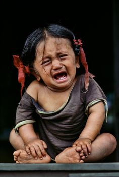 Crying child from Nepal by Steve McCurry