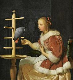 Caspar Netscher (Dutch, c 1635-1684) Young Woman Feeding a Parrot