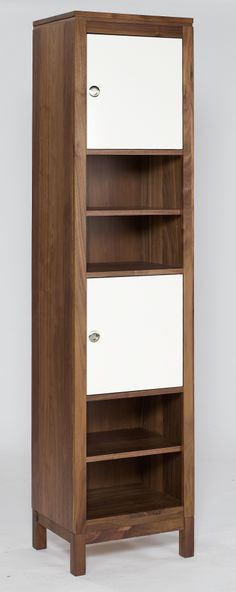 Tall Storage Unit  A classy and practical storage unit comprising solid American black Walnut, Walnut veneer and tasteful matt white door covers and incorporating quality, soft closing hinges.  Dimensions: H2008mm x W472mm x D370mm NB - This product comes fully assembled.