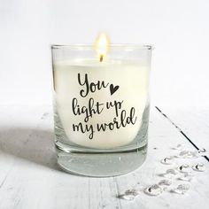 'You Light Up My World' Scented Candle  A gorgeous scented candle in a glass tumbler printed with the romantic quote 'You Light Up My World'.  Let someone know how they brighten your world.  This candle is perfect as a romantic gift for a loved one as a wedding or birthday gift, on an anniversary or Valentine's Day.