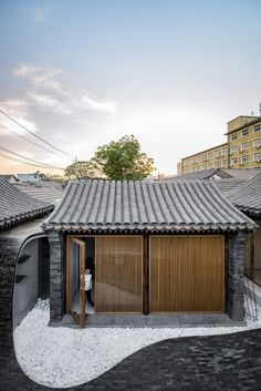 "goodwoodwould: ""Good wood - Beijing based Arch Studio renovated a traditional courtyard house in the Chinese capital, adding grey-brick paving that flows from the floor of the outdoor space to form internal walls and roofs. All combined with minimal. Architecture Résidentielle, Studios Architecture, Japanese Architecture, Creative Architecture, Futuristic Architecture, Contemporary Architecture, Chinese Courtyard, Chinese Interior, Brick Paving"