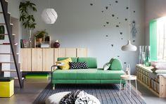 Modern nappali, FLOTTEBO kanapé ággyal, zöld színben, kisasztallal.