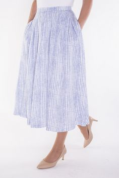 The versatile midi skirt: Everyone's favorite skirt length works just as well with flats as heels.  Crisp, clean, blue & white printed midi skirt offers a fresh take on a classic iconic look.