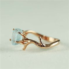 Unique Branch and Natural Blue Topaz Ring, branch ring, nature, rose gold, unique, gemstone, topaz, birthstone, raw cut, uncut, rough cut by 4FireflyCollections on Etsy https://www.etsy.com/listing/158624835/unique-branch-and-natural-blue-topaz