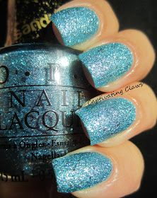 "Captivating Claws: OPI Bond Girls Liquid Sand Polishes.  "" TIFFANY CASE "" (medium blue metallic base with silver glitter)"