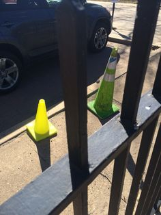 Traffic Cones Behind Fence
