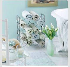 Cool Towel Storage Idea Using Wine Rack