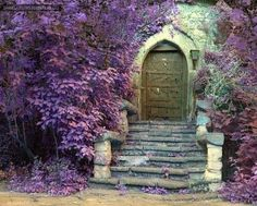 Antique exterior wood door with stone stairs and flowers. Adding antique wood doors to home interiors enhance the house design in vintage style, and make interior design and house exterior design feel harmonious and attractive. Sleeping Beauty Art, The Secret Garden, Secret Gardens, Wood Exterior Door, Building Exterior, All Things Purple, Purple Stuff, Windows And Doors, Arched Doors