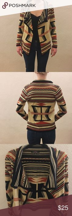 Tribal pattern shawl collar cardigan This cozy sweater has a combination of soft stretchy fabric, and beautiful warm toned colors. With its fitted sleeves, asymmetrical shape and waterfall neckline it is very flattering for all body types. spicy girl Sweaters Cardigans