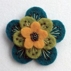 """Folksy :: Buy """"Layered felt brooch"""" - Fabric Crafts A beautiful, feminine brooch made from 3 layers of scrumptiously thick wool felt.Embroidered and beaded with metallic rainbow seed beads, and firmly attached to a 1 Felt Diy, Felt Crafts, Fabric Crafts, Felt Flowers, Fabric Flowers, Felt Embroidery, Felt Brooch, Beaded Brooch, Brooches Handmade"""