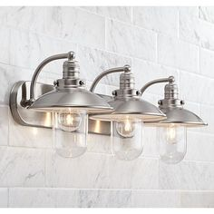 This bathroom light features clear glass for bright and stylish illumination.
