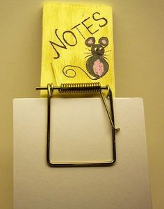 mouse trap converted to a message/note holder.  Easy to do.