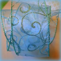"""Icy Blue  Glitter Swirl 2.5"""" x 3m  Wide Wire Edged Ribbon, Organza Ribbon, Christmas, Birthday, Cakes Celebration, Cake, Bow, Tree, Trim Christmas Wired Ribbon, Packaging Supplies, Special Occasion Outfits, Organza Ribbon, Tape Crafts, Blue Glitter, Christmas Birthday, Red Poppies, Swirls"""