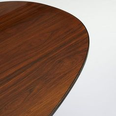 Arne Jacobsen, Piet Hein and Bruno Mathsson Super Ellipse table   Fritz Hansen   Denmark/Sweden, 1968/1975   rosewood, chrome-plated steel   165.5 w x 55.25 d x 27.5 h inches   Signed with decal manufacturer's label to underside: [FH Made in Denmark 1975 by Fritz Hansen].