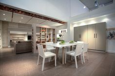 Our back Setting showing Quadrat Chairs, Pigreco Table, Frame bookcase from Tempo Libero range by Novamobili
