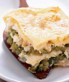 Tortilla Torta|Layers of cream, salsa, Monterey Jack cheese, and chicken bake in the oven until browned and bubbly.