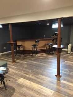 Beautifully installed Pole-Wraps with our Drink Shelves enhance the look of a very nicely finished basement. Another happy Pole-Wrap customer. Run down to your local Home Depot and get yours now! Man Cave Home Bar, Home, Basement Decor, Remodel, Basement Bar Designs, Basement Poles, New Homes, Waterproofing Basement, Basement Remodel Diy