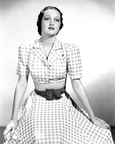 Dorothy Lamour in a charming midriff bearing warm weather ensemble.