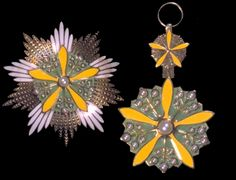 The Supreme Order of the Orchid Blossoms - Grand Cordon, breast star (L) and sash badge (R).   Ta Hsun Wei Lanhua Chang (the Supreme Order of the Orchid Blossoms): founded by Emperor Kang Teh [Hsuan-tung] of Manchuria on 19th April 1934. Awarded in two classes:  1. Ta Hsun Wei Lanhua Chang King-shin (Grand Collar) - Heads of State and holders of the Grand Cordon.     2. Ta Hsun Wei Lanhua Chang Ta-shou (Grand Cordon) - holders of the Grand Cordon of the Order of the Ray of the Dragon.