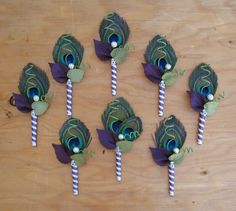 Peacock boutonnieres @Taryn Beers I think I am obsessed with finding peacock stuff for your wedding!!! :)