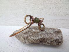 Brass swirl hand forged bangle wrapped with jade by Amayeli, $18.00